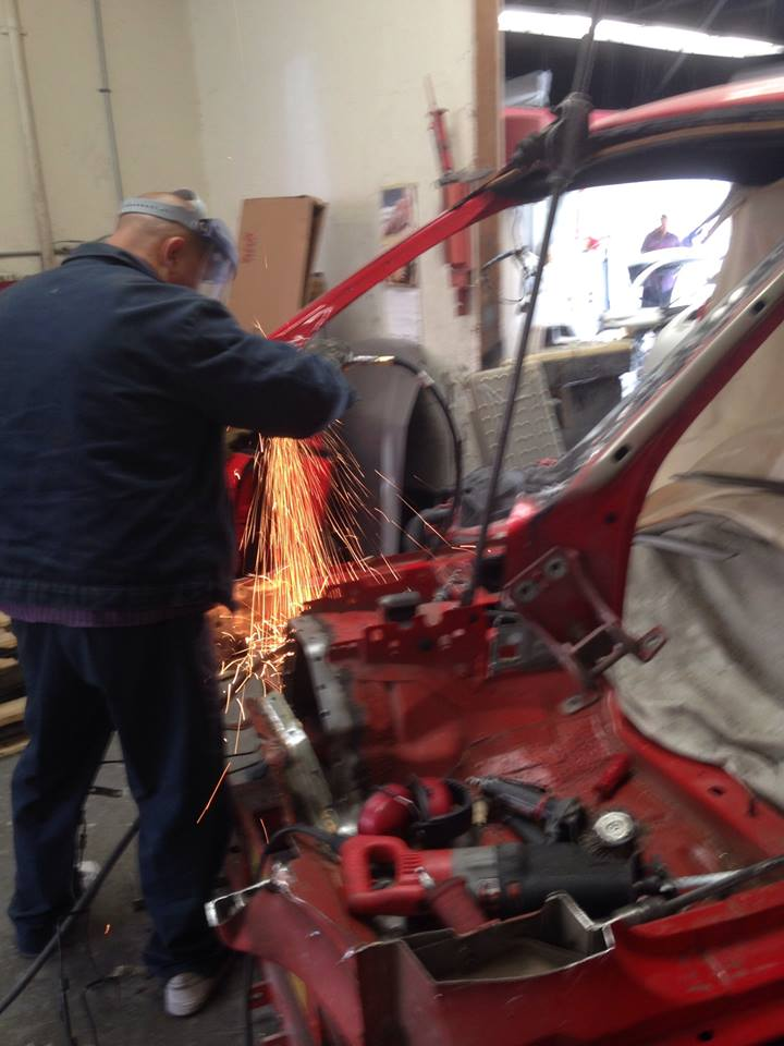 working on red car